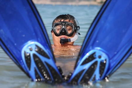 Funny snorkel man in the sea photo