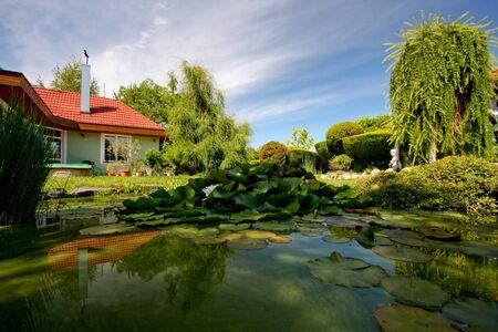 lake house: Slovakia house and garden lake with water lily - Slovakia, Europe