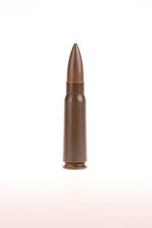 single AK 47 round - isolated on white photo