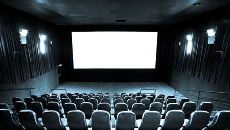 famous industries: Empty hall of cinema and white screen Stock Photo