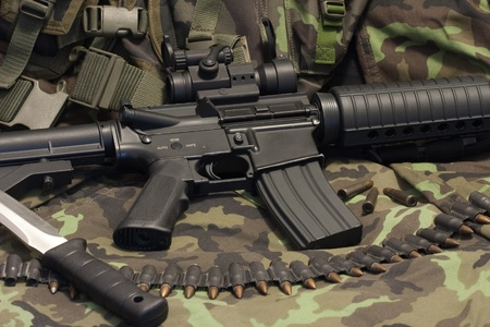 modern weapon M4, camouflage background