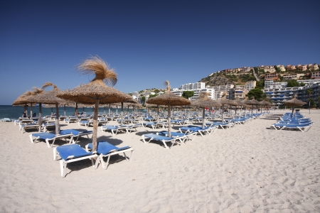 Mallorca beach, Santa Ponsa,  umbrella and deck chairs Stock Photo - 13341648