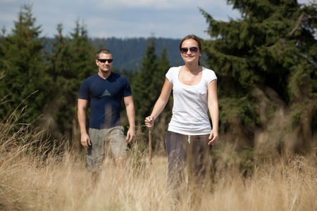 Couple hiking outdoors in nature Standard-Bild