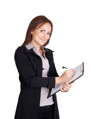 Businesswoman writing on a clipboard Stock Photo - 13378296