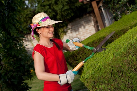 trimmers: Gardener woman with hedge trimmers