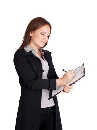 Businesswoman writing on a clipboard Stock Photo - 13378283
