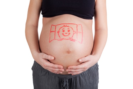 girl belly: Pregnant woman with baby painted on her belly