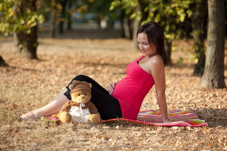 Pregnant woman in the park photo
