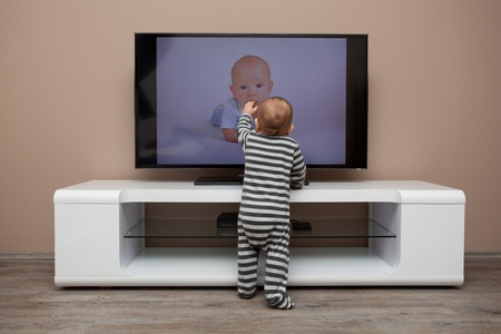 screen tv: baby boy watching TV at home