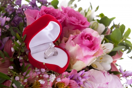 Betrothal detail of the rings and bouquet photo