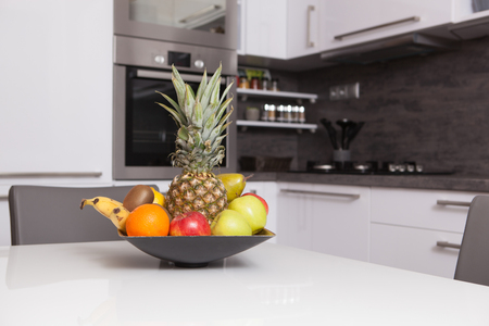 fruit bowl in a kitchen photo