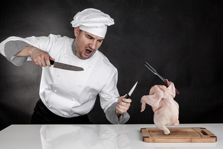 Angry cook fighting with knifes  Raw chicken attack
