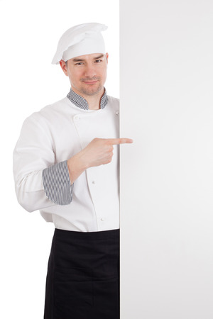 culinary skills: Chef pointing finger to white blank board