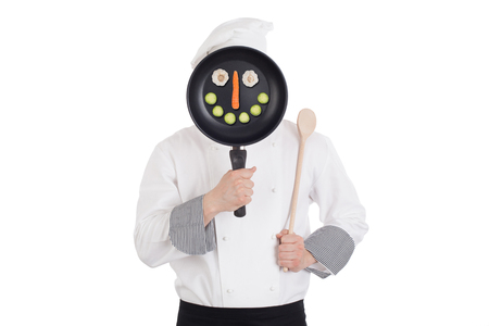 Chef behind pan. Isolated on white background. photo