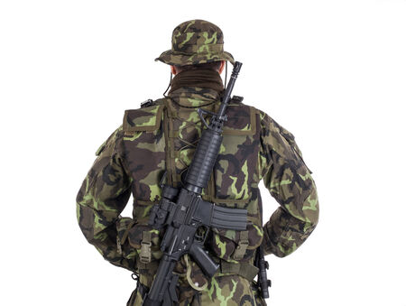 Soldier in camouflage and modern weapon M4  Isolated photo