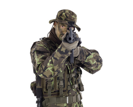 military men: Soldier in camouflage and modern weapon M4  Isolated