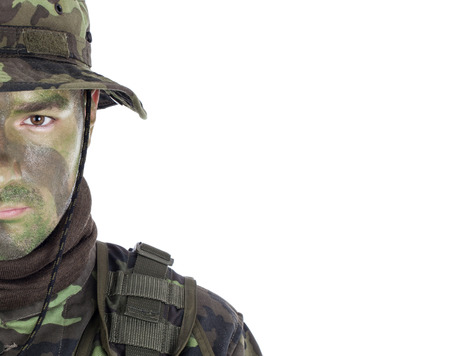 Young soldier with jungle camouflage paint  Isolated