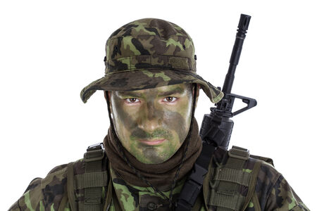 face paint: Young soldier with jungle camouflage paint  Isolated  Stock Photo