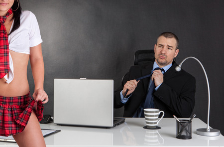 harassment: Sexual harassment. Sexy woman is seducing her boss at office