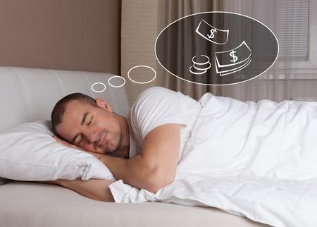 Slaap jonge man en dromen over geld