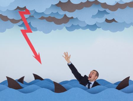 competitive business: Businessman surrounded by sharks in stormy sea and business graph down. Competitive business concept.