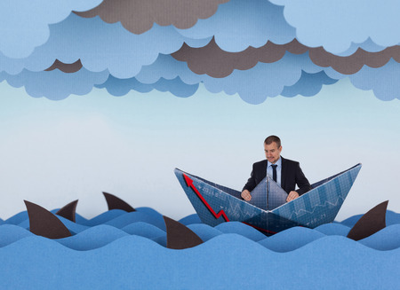 competitive business: Businessman surrounded by sharks in stormy sea. Competitive business concept. Paper waves, clouds, boat and sharks. Stock Photo