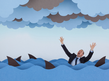 Businessman surrounded by sharks in stormy sea. Competitive business concept
