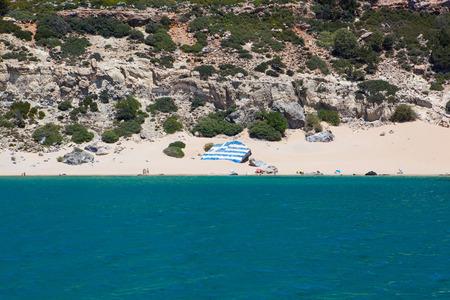 Tsambika beach with Greece flag, Rhodes island