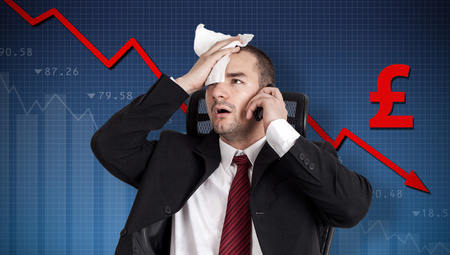 Pound crisis, currency collapse. Broker holding forehead