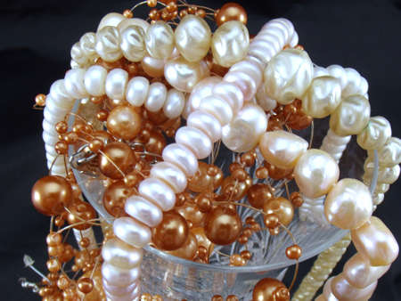 pearls and beads on black background photo