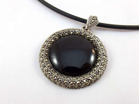 black pendant on white background photo