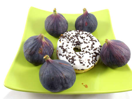 cokies and figs on white background photo