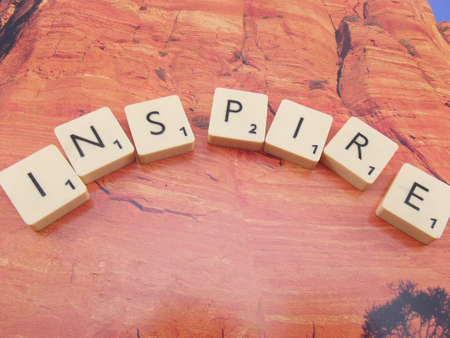 word inspire on abstract background Stock Photo - 15568838