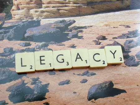word legacy on abstract background Editorial