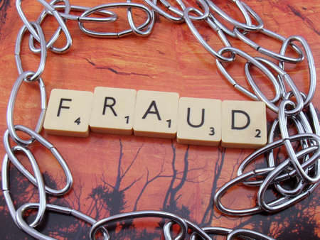 word fraud on abstract background Stock Photo - 15569756