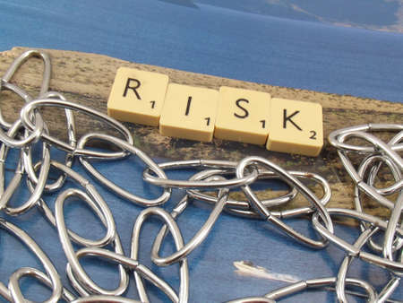 word risk on abstract background photo
