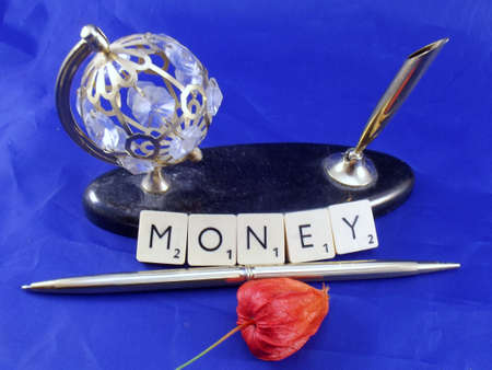 word money on blue background photo