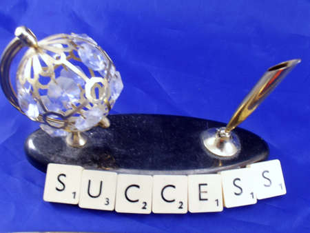 word success on blue background Stock Photo - 15571137