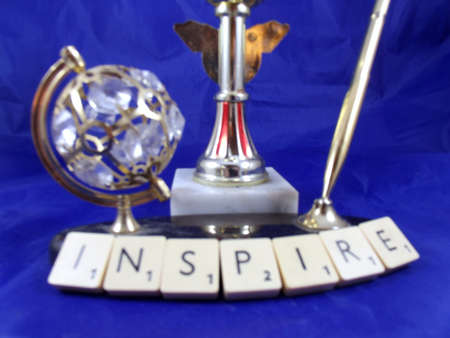 word inspire on blue background photo