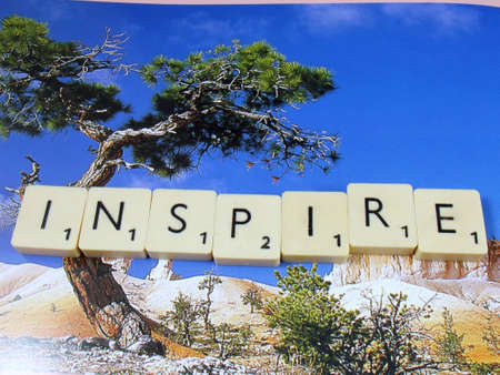 word inspire on abstract background photo