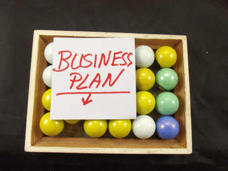 word business plan on black background photo