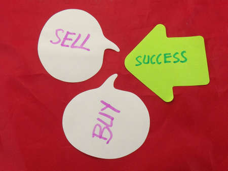 word sell,buy,success on red background photo