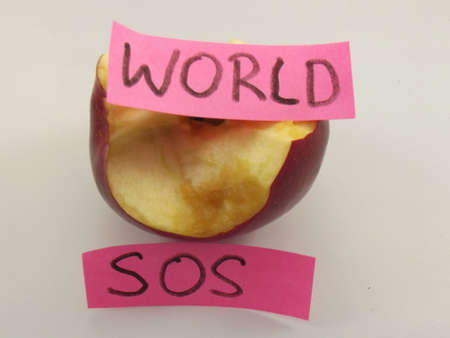 nibbled apple and word sos,world  photo
