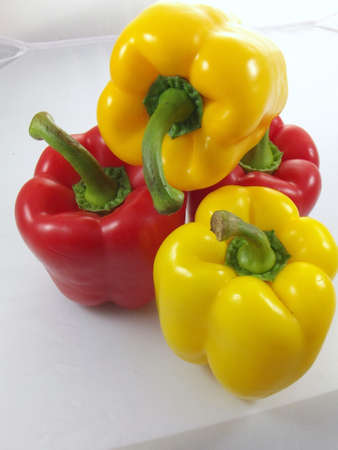 colorful peppers on white background photo