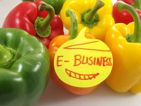 word e-businessand colorful peppers photo