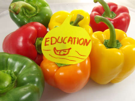 word educaction and colorful peppers photo