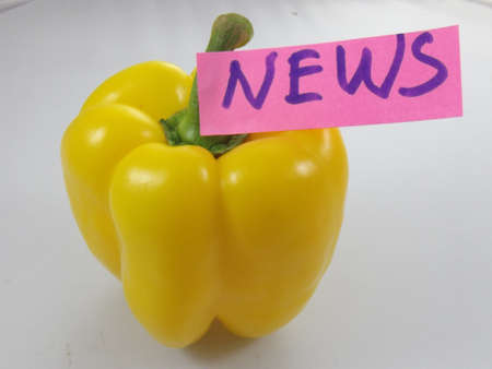 word news and yellow pepper on white background Stock Photo - 16914774
