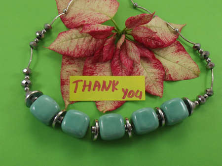 word thank you on green background Stock Photo - 17421396