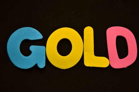 joyas de oro: ord oro sobre negro Foto de archivo