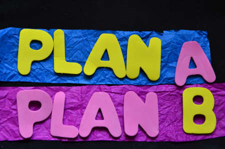 word plan a,plan b on black background photo